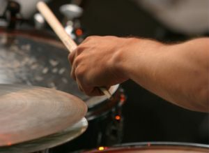 a person holding drum sticks