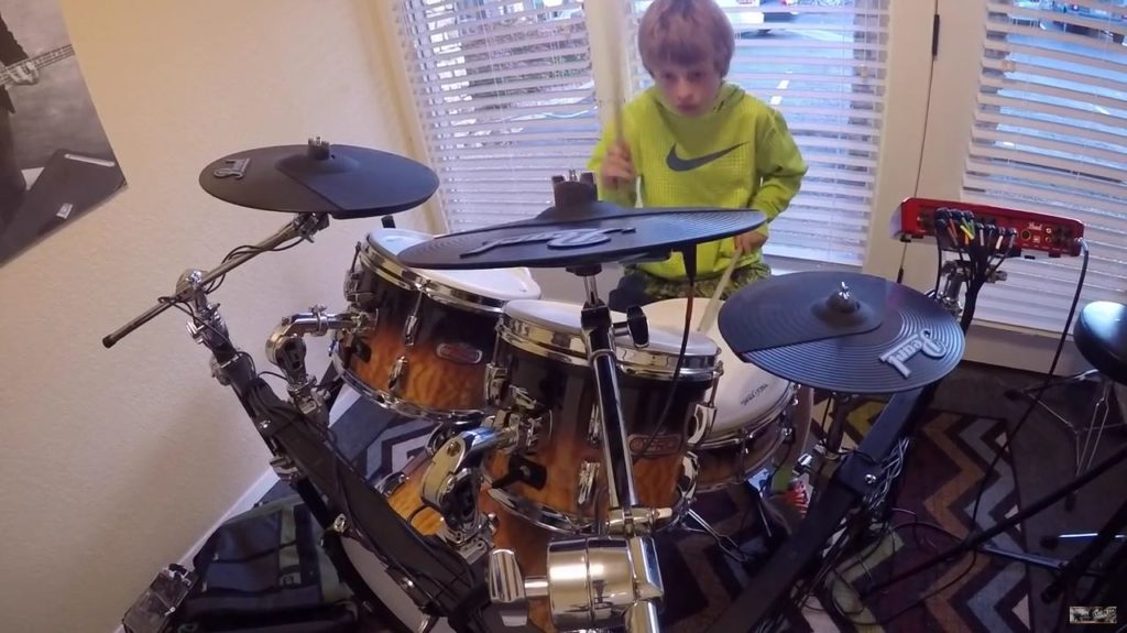 A kid practicing drums