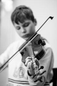 A boy playing violin