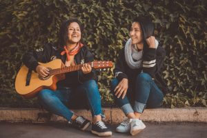 Playing Guitars Benefits of Taking Music Lessons Austin
