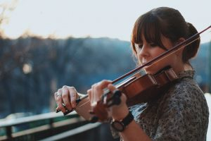 Girl Playing Violin Music lessons austin